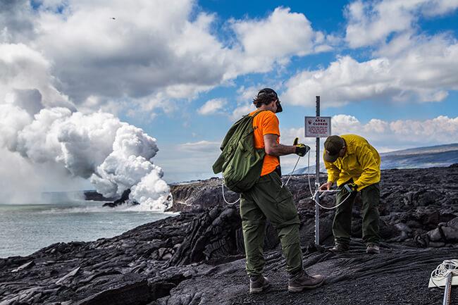 Eruption crew rangers work to reestablish the Kamokuna lava viewing site. NPS Photo / Janice Wei.