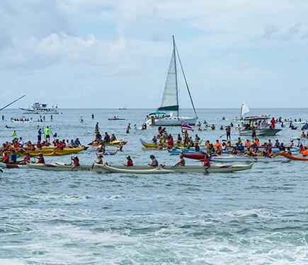 A fleet of canoes, boats and SUPers awaited Hokulea
