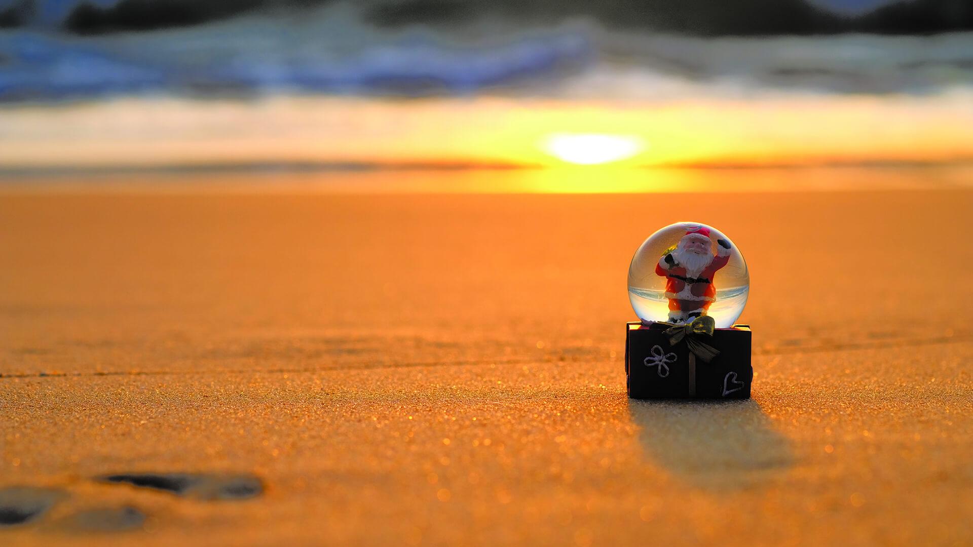 Santa Snow Globe on a Beach