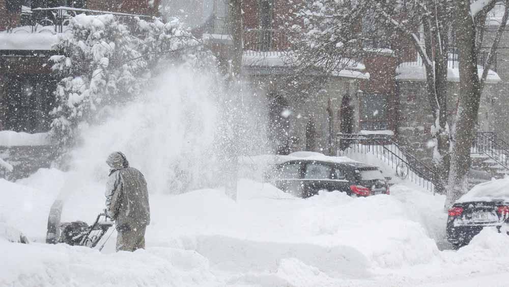 Snow blower in blizzard