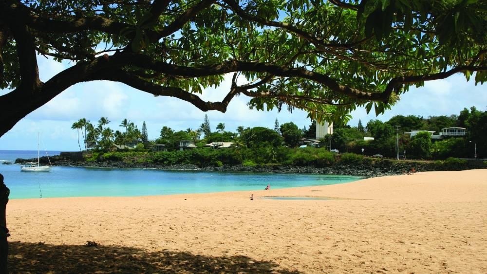 A calm Waimea Bay during summer
